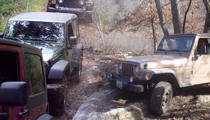Jeep vehicles navigating off-road trail together