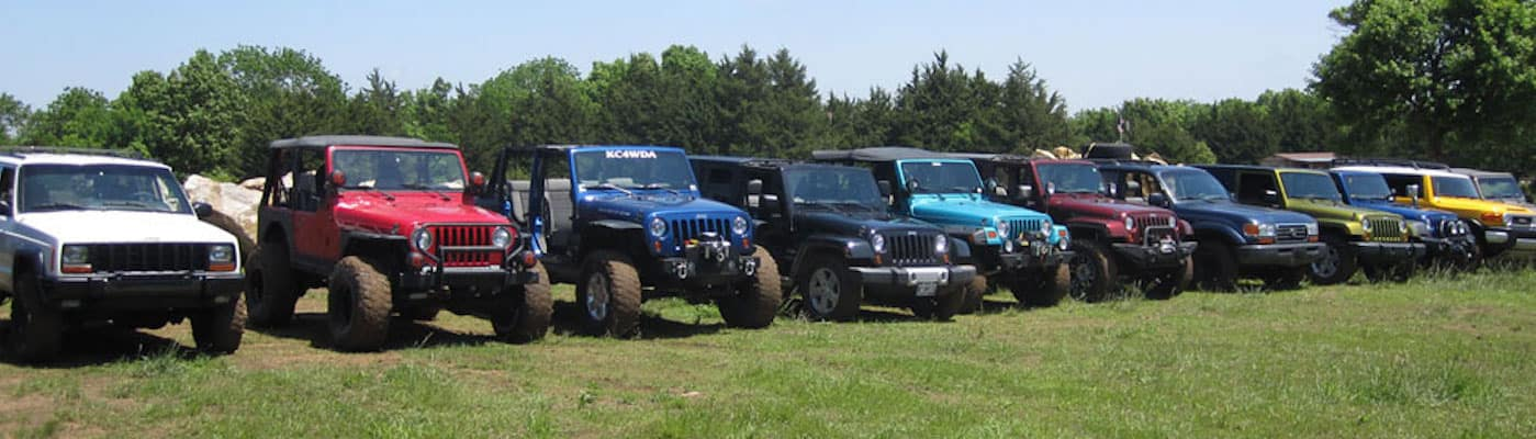 Jeep vehicles lined up on grass at Kansas Rocks Recreational Park