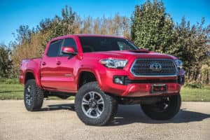 """Come check out our awesome 2016 TRD Sport Tacoma that we outfitted with a brand new Rough Country 3"""" Lift and 33"""" Tires. Call 309-245-7000 for best pricing."""