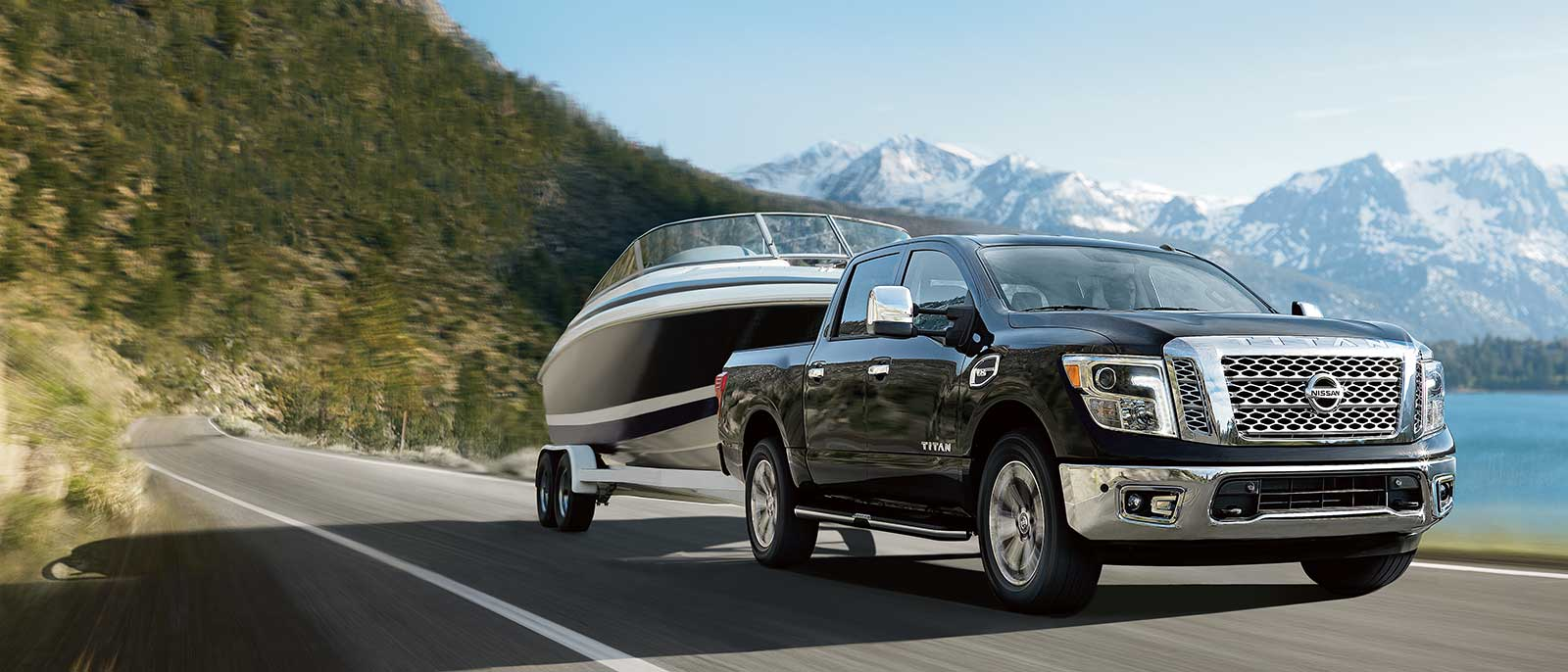 2017 Nissan Titan towing a boat in the mountains
