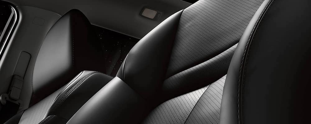 Black 2019 Nissan Rogue leather seat with light reflection