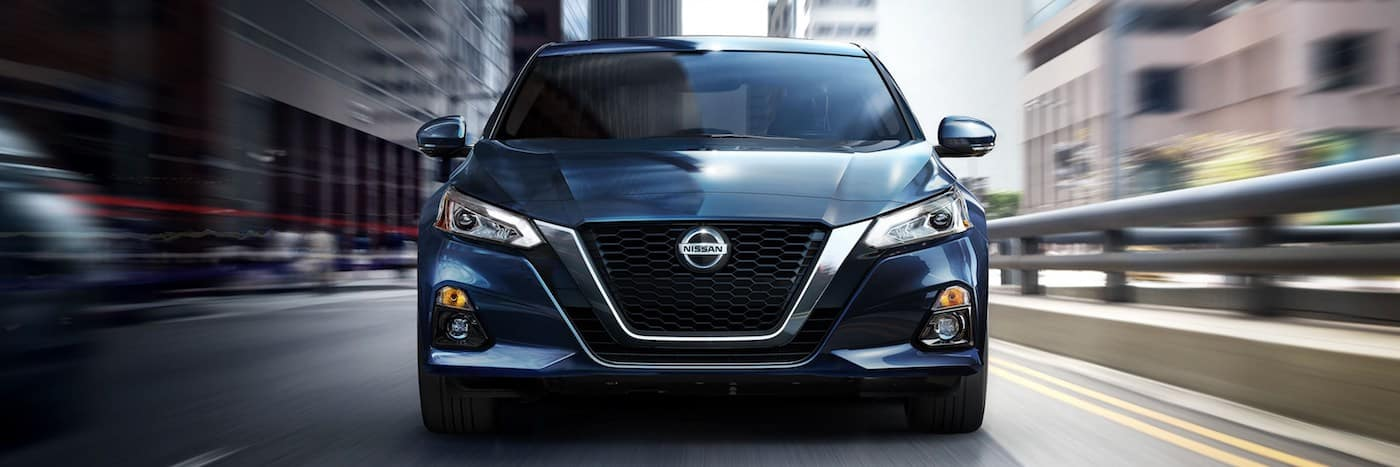 A head on shot of a 2020 Nissan Altima driving on a city street