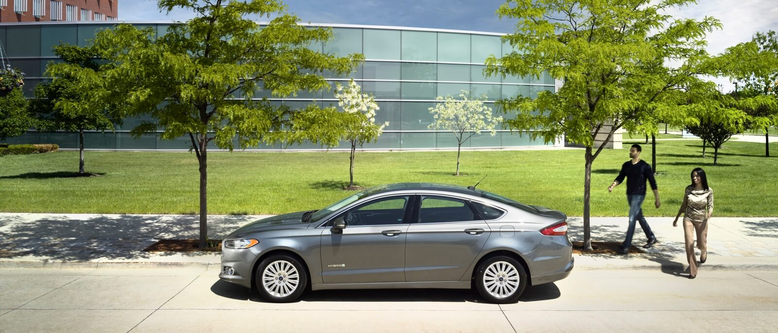 2016 Ford Fusion Hybrid light gray exterior on display