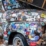 Old car covered in stickers