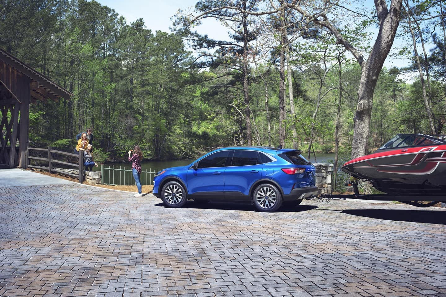 2020 Ford Escape towing boat on brick road