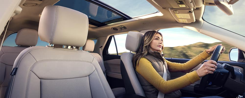 Woman driving Ford Explorer