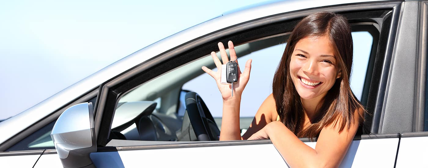 Young girl buying a car