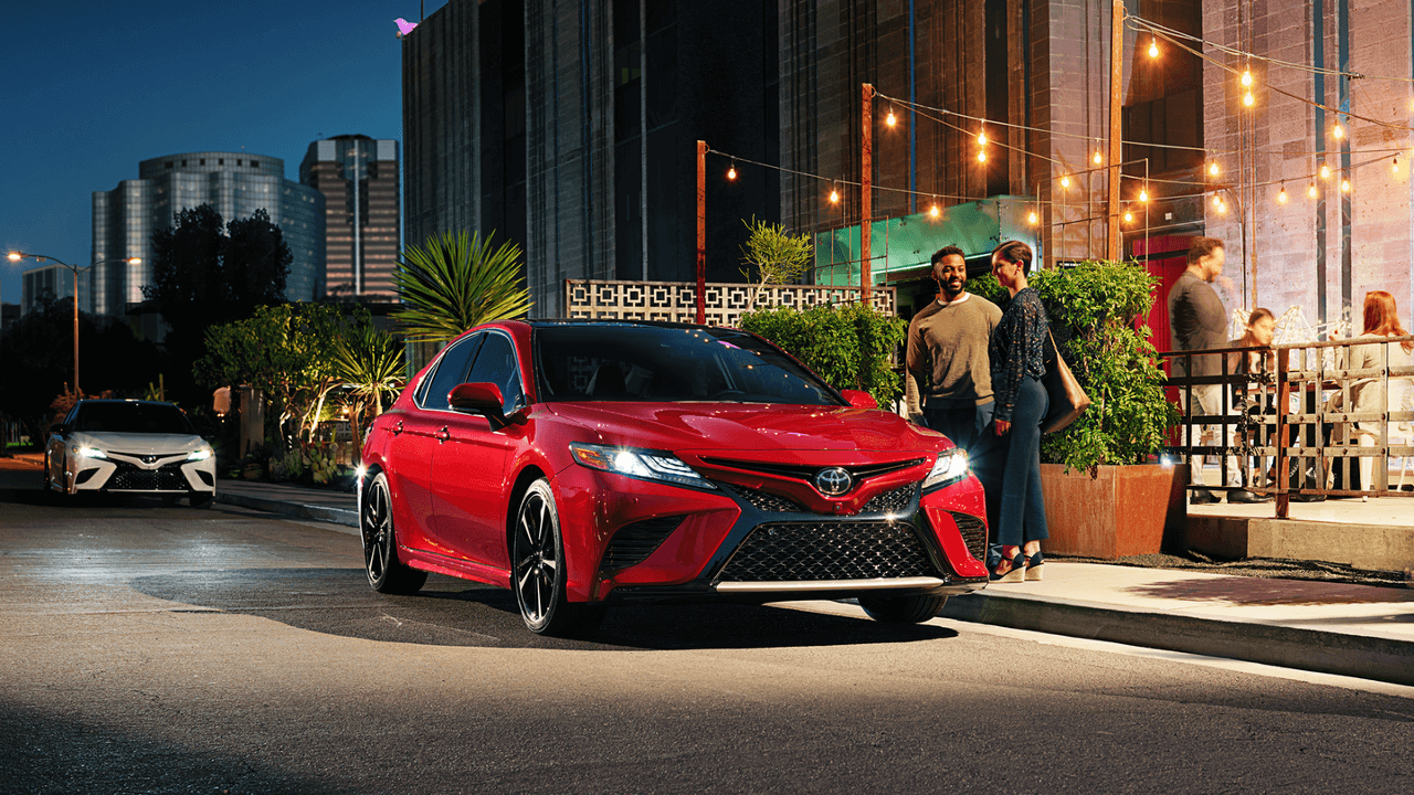 2018 Toyota Camry XSE parked outside restaurant