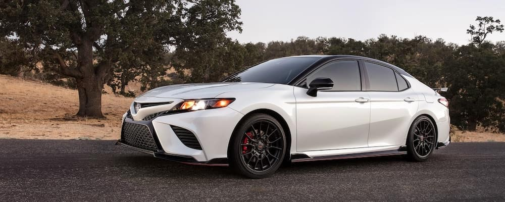 A 2020 Toyota Camry TRD waits to accelerate on pavement.