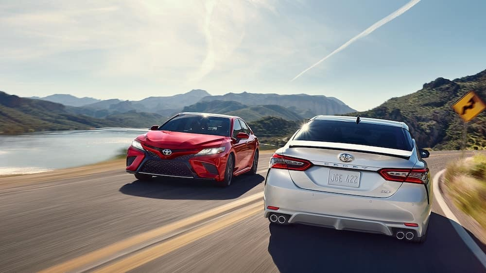 2020 Camry models going in opposite directions on a road