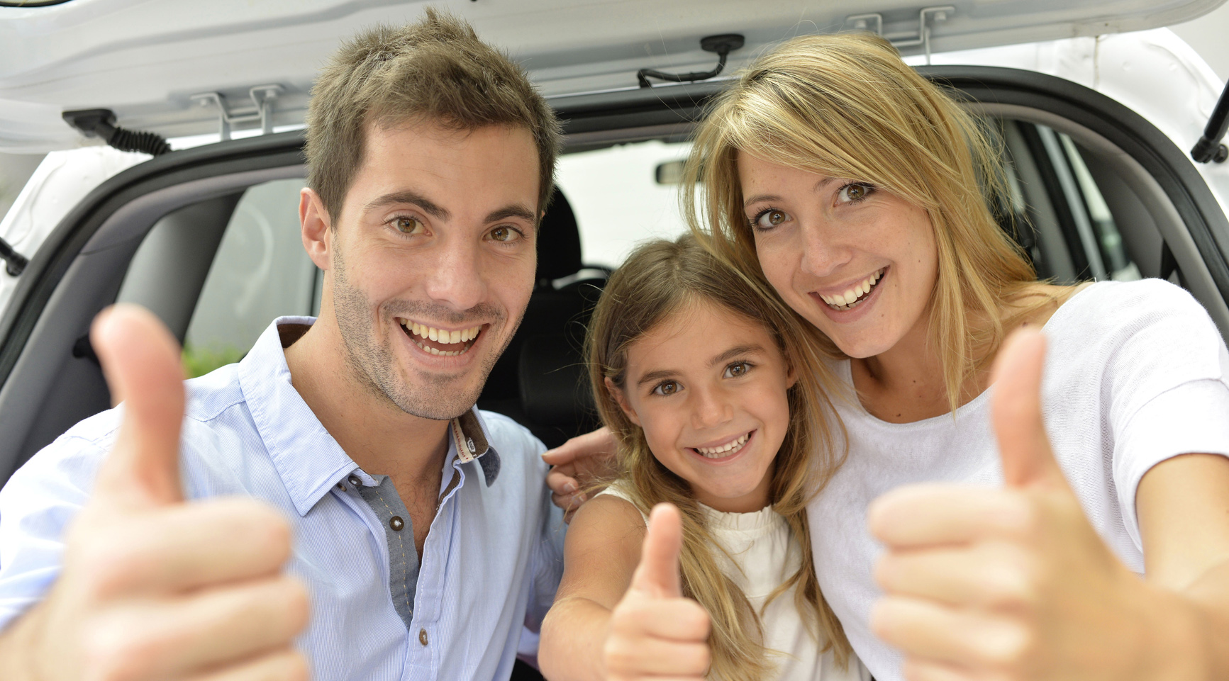 Family Thumbs Up in Car