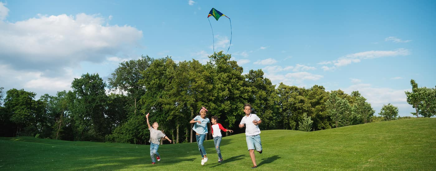 Kids flying a kite in a park