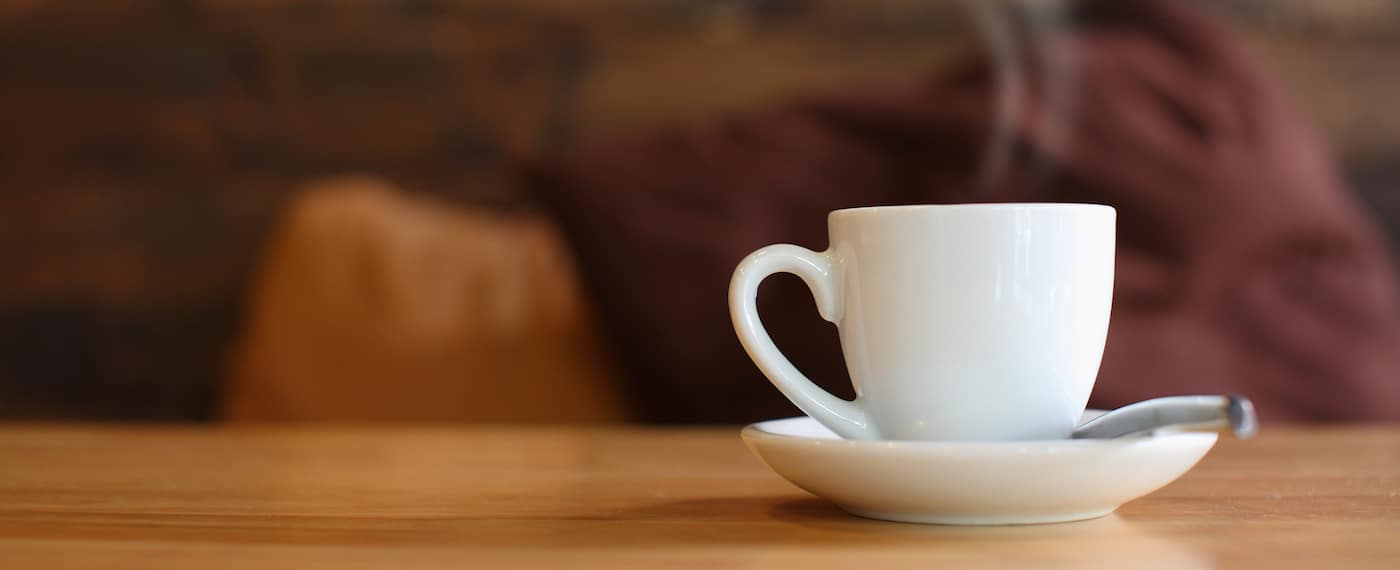 Coffee cup on a cafe table