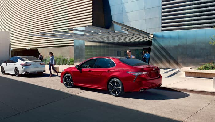 Red 2019 Toyota Camry Parked in Street