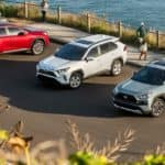 High angle on three 2019 Toyota RAV4s parked alongside beach
