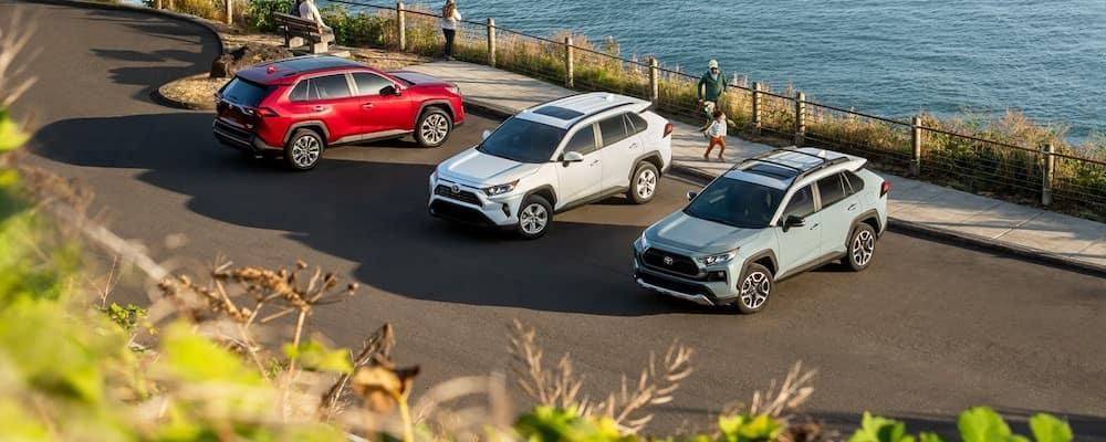 High angle on three 2019 Toyota RAV4s parked alongside beach