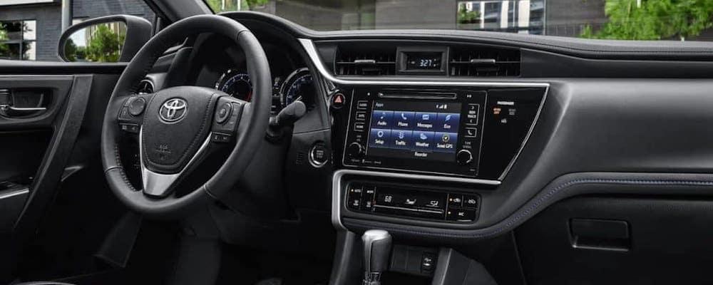 Interior dash console and wheel of 2018 Toyota Corolla