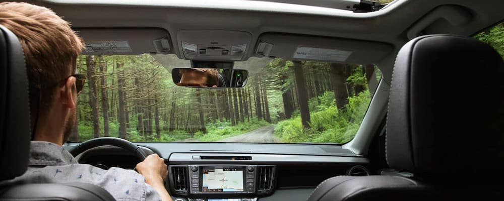 Man driving through woods in 2018 Toyota RAV4
