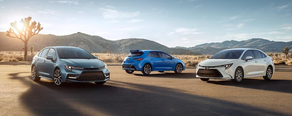 Three 2020 Toyota Corolla models in desert with mountains in background