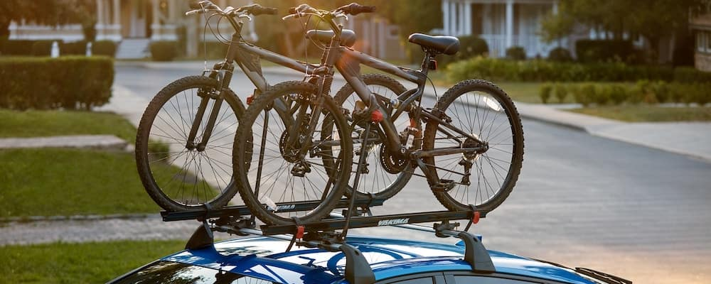 Bikes on top of Blue 2020 Toyota Prius XLE AWD-e
