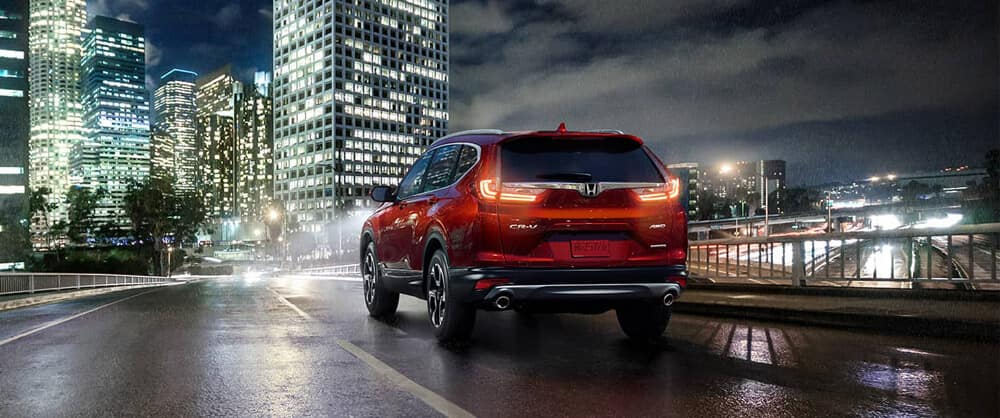 Rear View of Red 2018 Honda CR-V Driving at Night