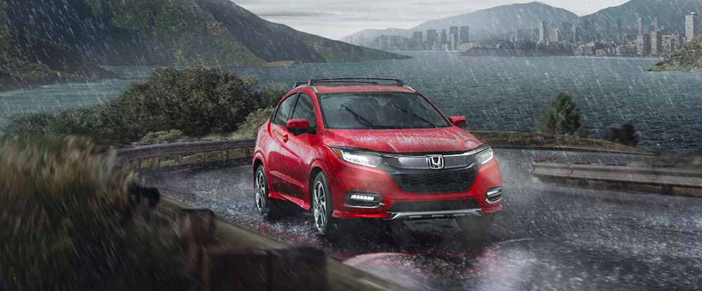 Red 2019 Honda HR-V Touring AWD driving in rain