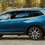 2020 Honda Pilot with family opening trunk cargo space