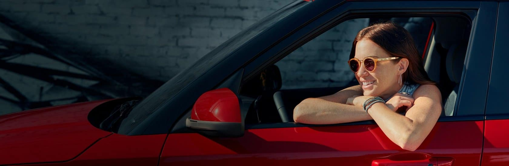 Happy woman in a Hyundai
