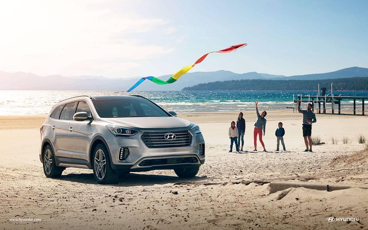 2017 Hyundai Santa Fe on the beach with a family