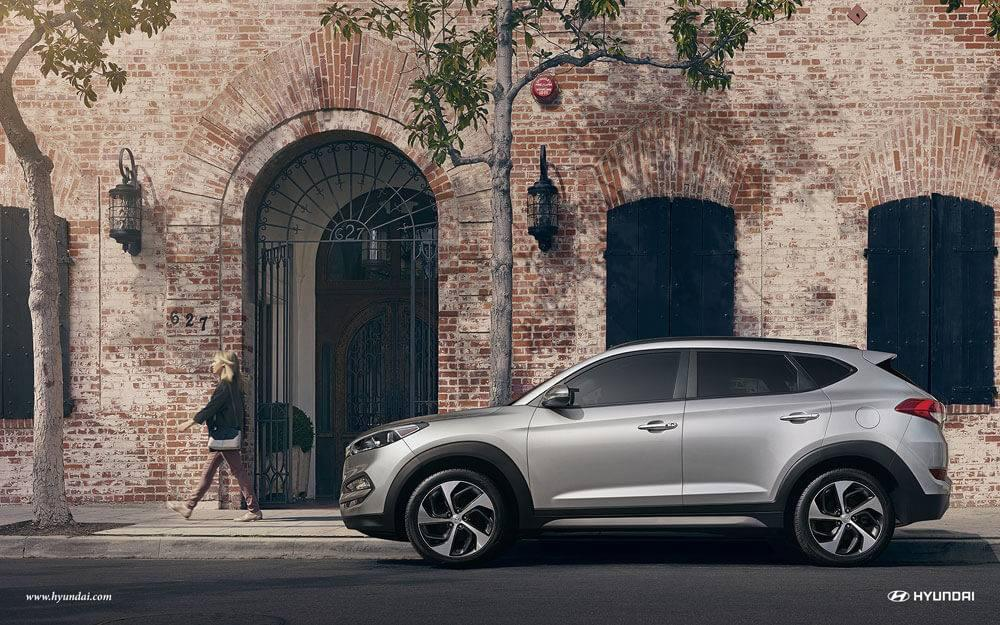2017 Hyundai Tucson in front of old building