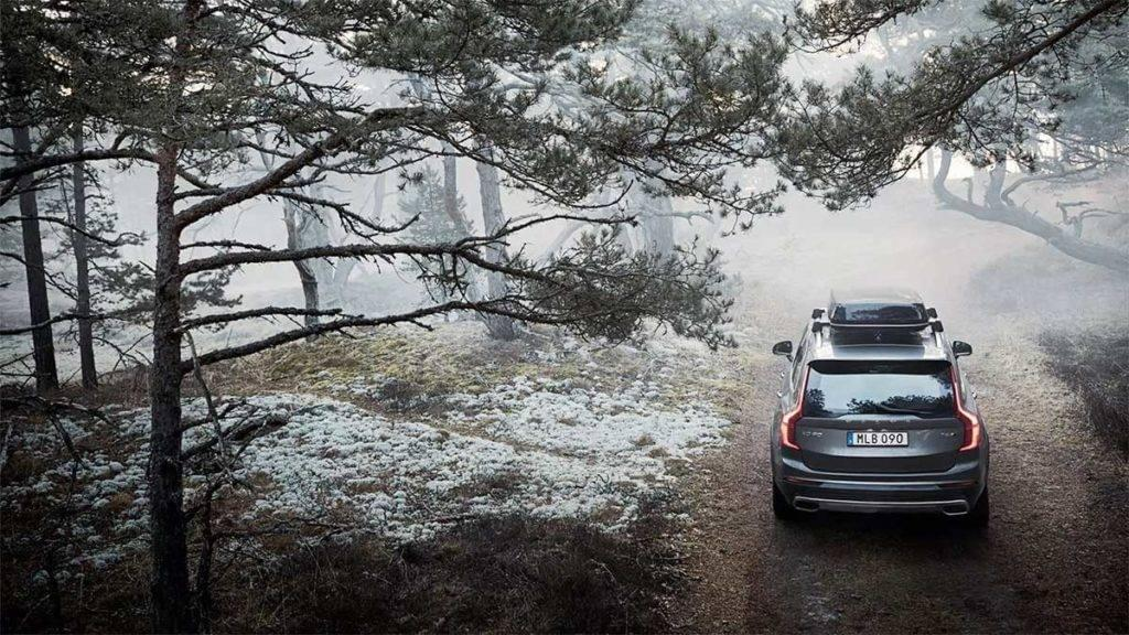 2017 XC90 driving through a misty forest