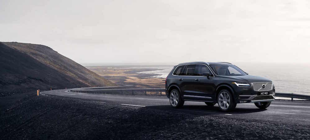 Volvo XC90 driving on highway near mountains