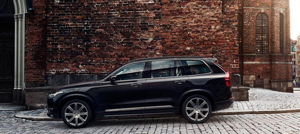 2019 Volvo XC90 parked along brick wall