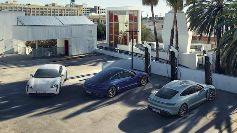 Three Porsche Taycan models using a Porsche Charing Network Station