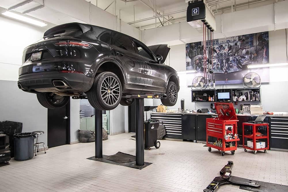 Black Porsche Vehicle Being Serviced